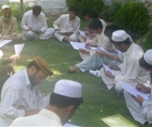 In Nangarhar, the community joins together to listen to A Story of a Village