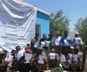 Fruit and vegetable farmers from Parwan province proudly display their contract farming agreements after the signing ceremony on