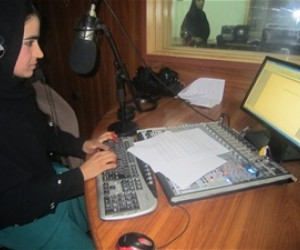 Khatira hard at work at a radio station in Lashkar Gah
