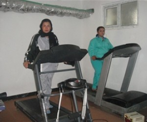 Shamim (on the left) tries out the new treadmill she bought with the loan