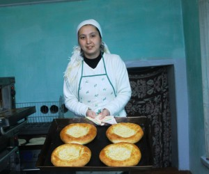 Nurjamal by the freshly baked bread