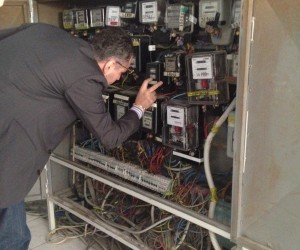 Man helping to detect illegal activity on a meter box
