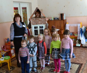 Children are playing an energy saving game at the Zhaludok day care center.