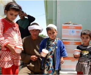 Mohammed Sadeq's children receive the food supplements handed out by the World Food Program in Shiberghan district