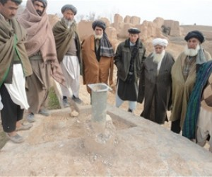 Labaabe Baala villagers cluster proudly around the well they paid to repair themselves