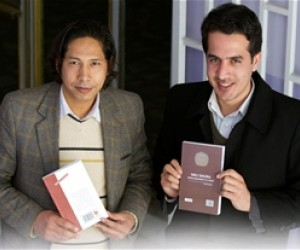 Author Javid Kotwal (on the left) and publisher Mohammad Hussain Mohammadi displaying their newest offerings, each with an ISBN