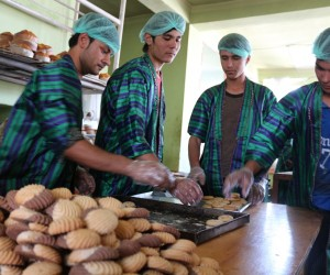 Workers at a bakery that participated in food safety training take pride in their sanitary surroundings and their new uniform
