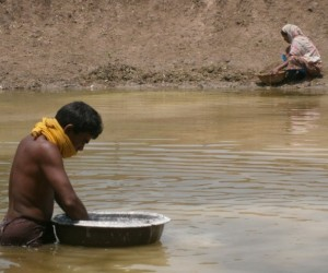 Photo of husband and wife building fish pond for fish farming
