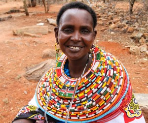 Nalan'gu Lokoloto wearing some of the colorful traditional jewelry helping her make a living.