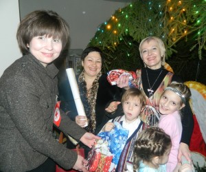 Tatiana Pukalo hands out Christmas gifts to children with disabilities at a community charity event
