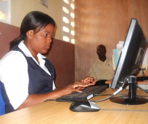 Municipal staff process tax payments on software locally developed for the Haitian context.