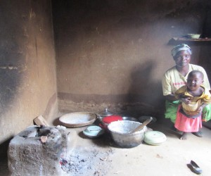 Merifa Muvwera and daughter, Loveness, portioning nsima, Malawi's staple food, after preparing the meal on their improved cookst