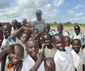 Children at Payuer Primary School in Renk, South Sudan, with the school's founder and head teacher, Ali Kenyi