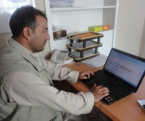 Homayon Rawoofi, senior loan officer of Shelter for Life in Takhar province, enters loans in the tracker system.