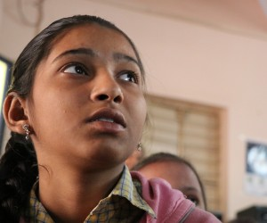 Khushiya, 13, follows along as a computer program that guides her English lessons narrates a story about a tree and its leaves.