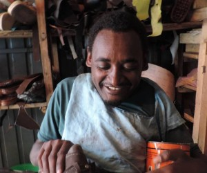 "Melesse Yohannes uses his ""Rough Rider"" wheelchair to go out and buy supplies for his shoe-making and repair shop."