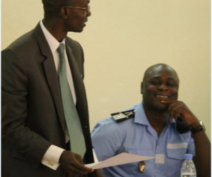A court officer and a police officer discusses in an office