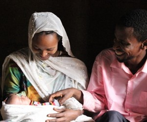 Nefisa and her husband with their 2-week-old daughter.