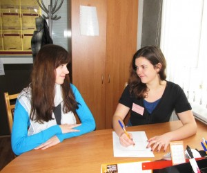 Legal clinic student consults with a client.