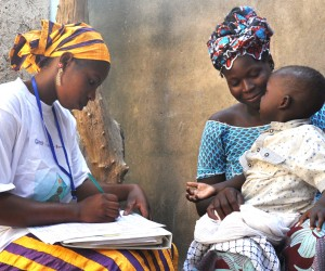 Community health worker tests 2-year-old boy for malaria in Mali.