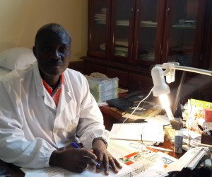 Dr. Anwanzi Ahui working at a desk