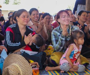 Villagers in Nakhayom applaud at an event to distribute long-lasting, insecticide treated nets.