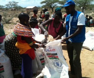 Women from Samburu County assist at a food distribution with help from UN World Food Program (WFP) staff.