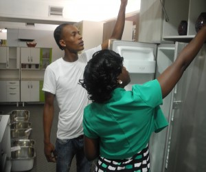 Shermon Bobb helps a customer