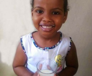 A Somali child loving her milk every morning
