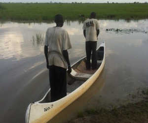 Two South Sudanese fishermen set out in a USAID-provided canoe to bring fish and much-needed goods back to their communities.