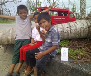 Photo of children eating emergency food bars