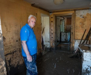 Man cleans mud from his home after devastating floods of May 2014 in Maglaj, BiH.