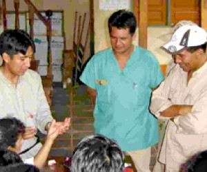 Dr. Viterman Ali, left, trains health providers and voluntary health workers in the Beni region of Bolivia how to use a malaria