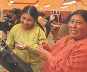 Embroiderers from Nueva Esperanza work hard to meet their export orders.