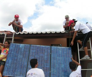 Youth learn how to install solar panels to power a computer center in the rural community of São João.