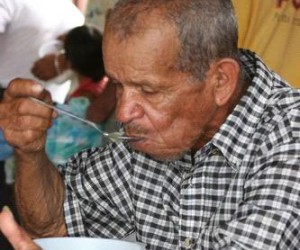 A man eating soup at an assistance center
