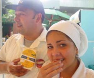 Lácteos Palmares employees taste cheese at the Second Cheese Festival in Tegucigalpa, sponsored by Land O'Lakes.