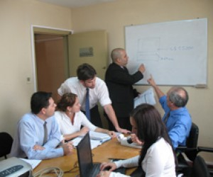 Technical staff review audit findings related to possible corruption charges in Paraguay.