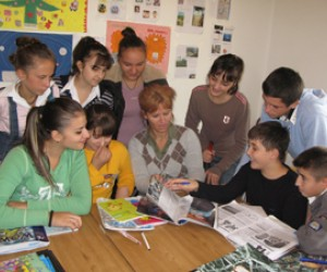Teaching from a wheelchair at home in Tirana, Teuta Halilaj (center) inspires her students with her positive attitude.