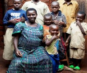 Genevieve Ndagijimana poses with her children. Thanks to USAID, the family now uses mosquito nets to protect against malaria