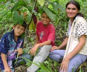 "After her husband was murdered and she was threatened, ""Maria"" (with her two sons in a cacao plantation) welcomed a chance to le"