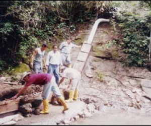 Workers make improvements to an aqueduct system for the municipality of Tello in Colombia.