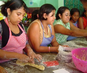 Young students learning to cook at an outreach center in Guatemala
