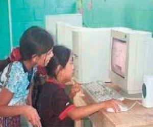 Mayan children and teachers use computers to learn and build self-esteem