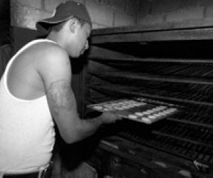 Omar and another former gang member work in a machine shop in Guatemala City.