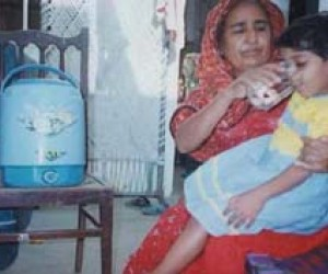 A Pakistani mother uses PuR treated water in her home. An estimated 250,000 child deaths occur each year in Pakistan due to wate