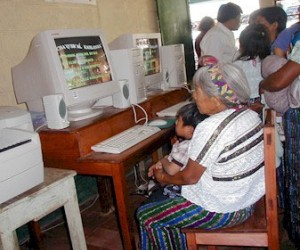Community members use computers at the rural school in Cunén, Quiché , Guatemala.