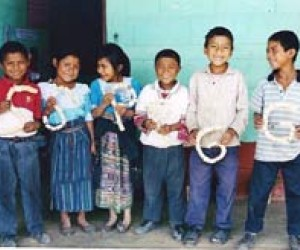 Maya K'iché schoolchildren in Quiché proudly display objects they made from recycled material.
