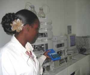 A technician at the Guyana Food and Drug Department Lab in Georgetown, Guyana selects samples to be tested with new equipment