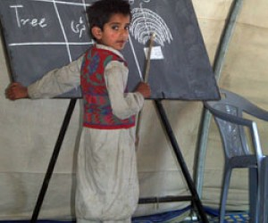 This student at a school in the Mehra Camp for displaced earthquake survivors in Pakistan leads his classmates in an English lan